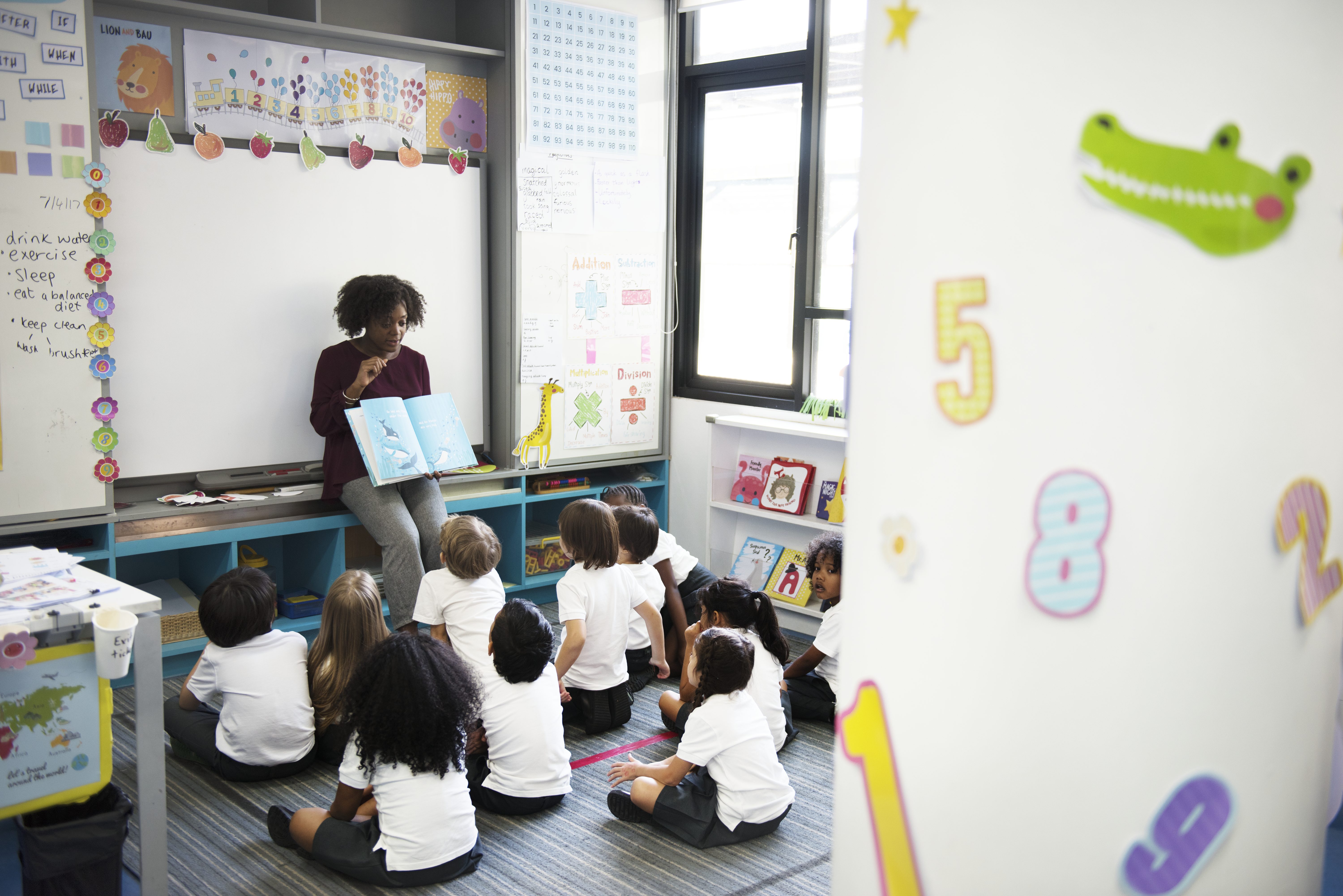 Woman reading a story to children