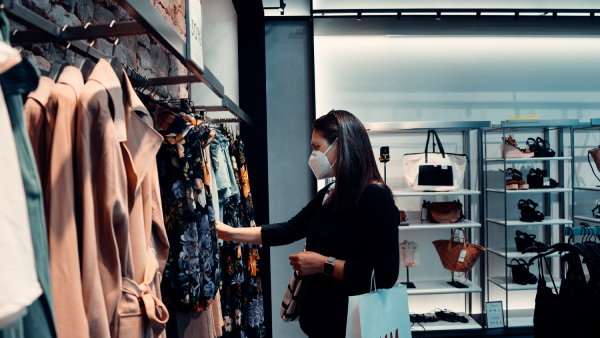 woman in market shopping during pandemic new normal wearing mask